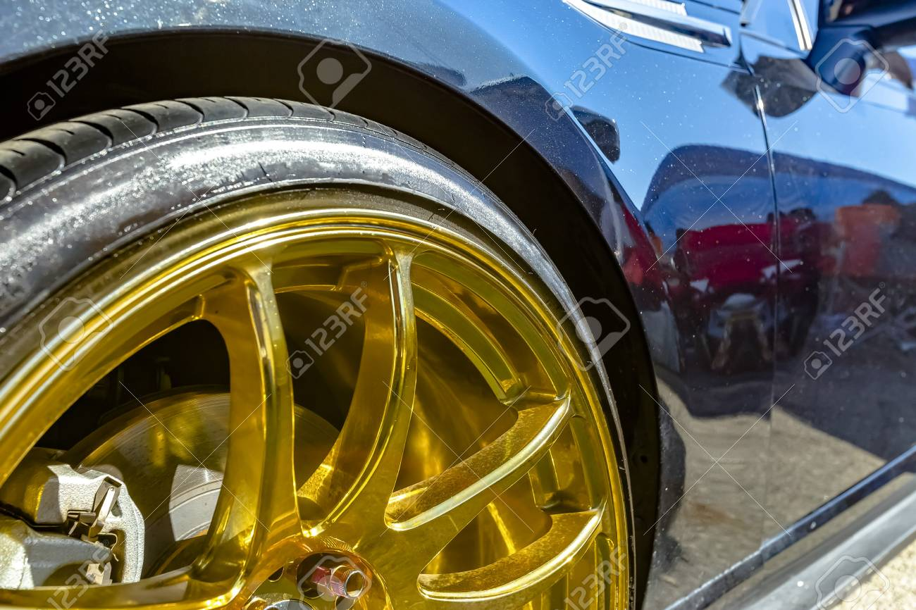 Golden Car Rims On A Black Car At An Event In Orange County