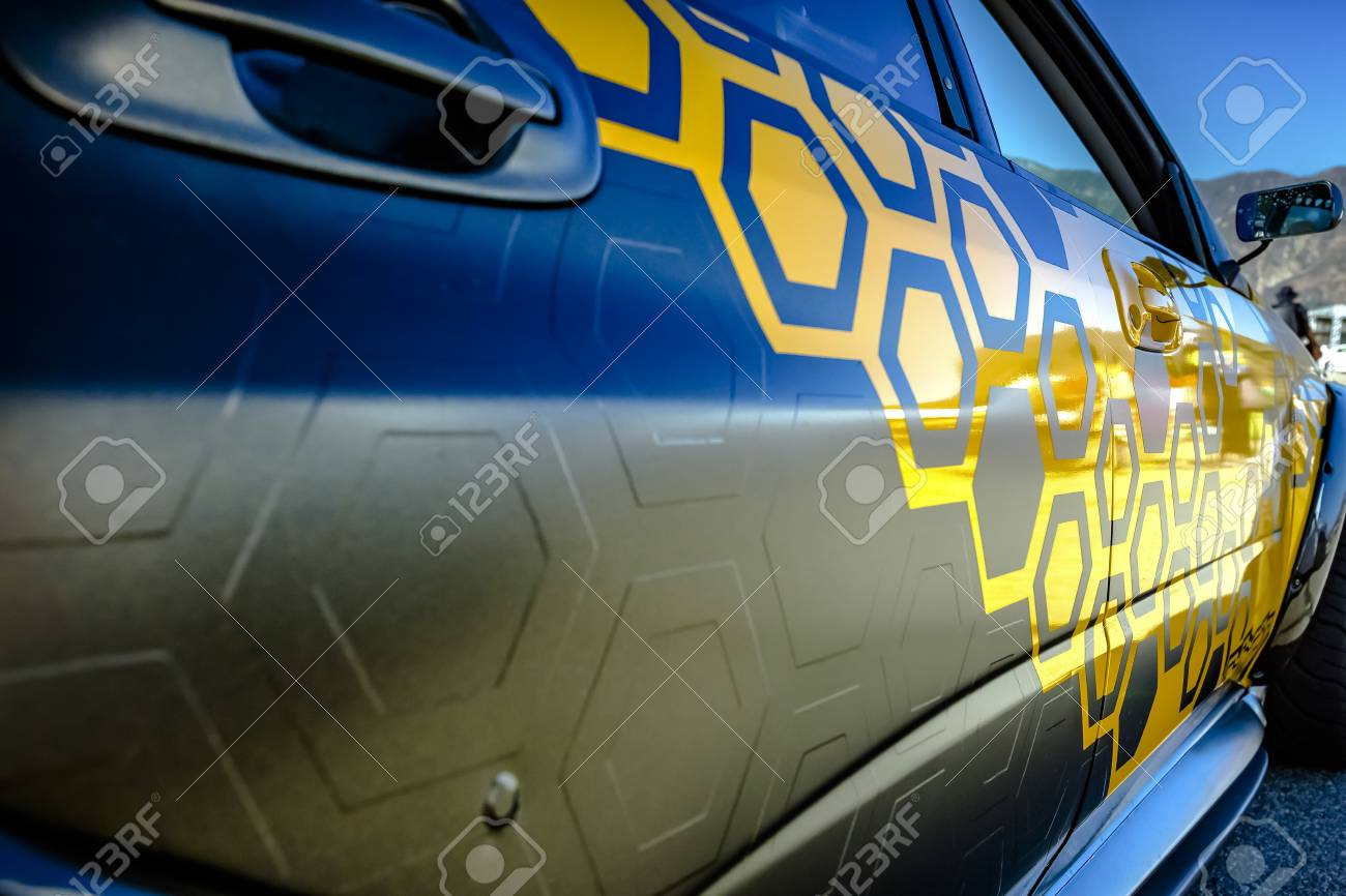 Pasting of car with carbonic vinyl wrap closeup. Various vehicle details in Southern California. - 91578776