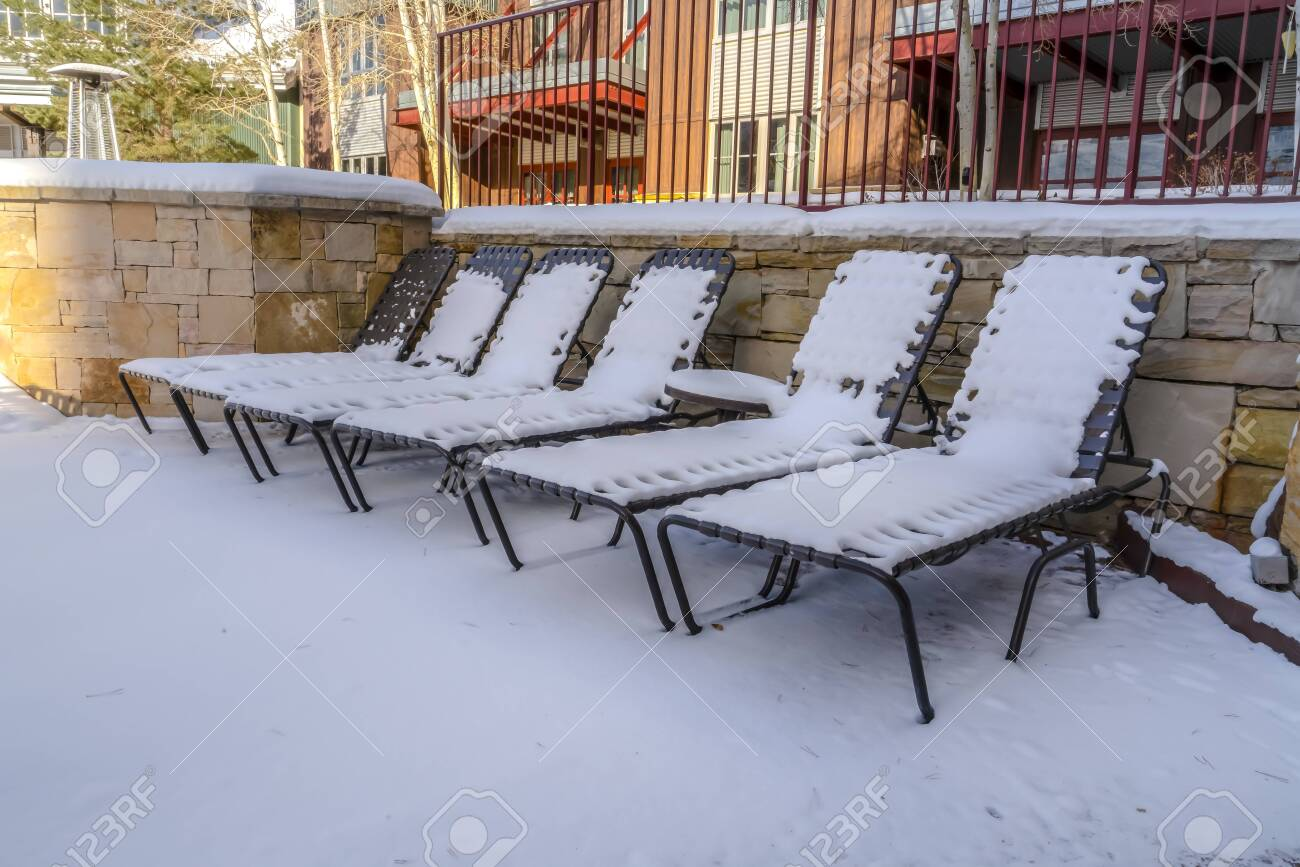 Cool Outdoor Chaise Lounge Chairs And Table Against A Building On Spiritservingveterans Wood Chair Design Ideas Spiritservingveteransorg