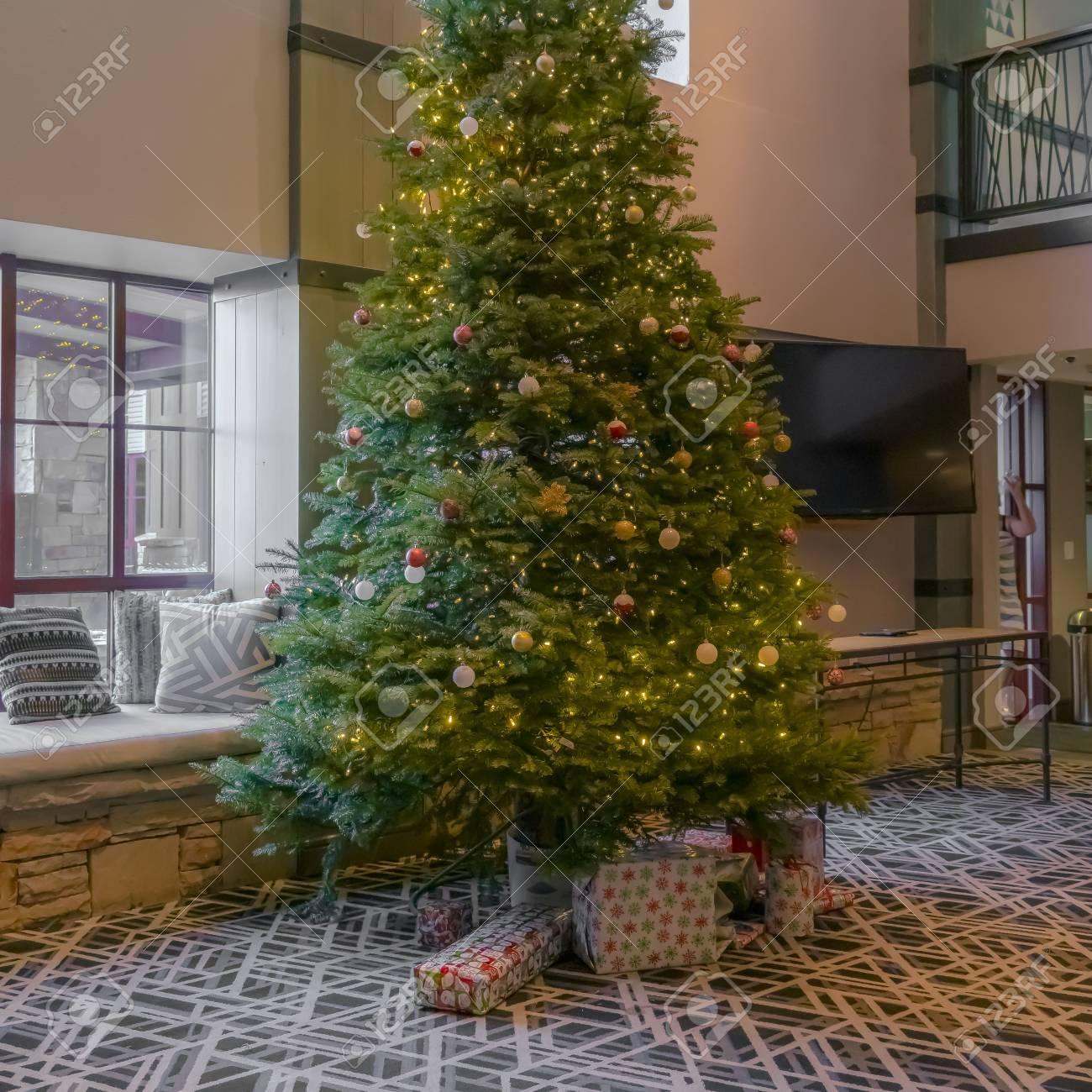 Traditional Christmas Tree.Square Traditional Christmas Tree Decorated With Baubles Lights