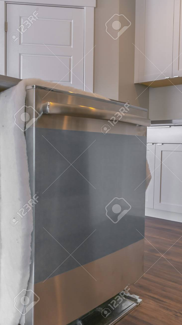 Panorama Close up of a dishwasher on a kitchen island against..