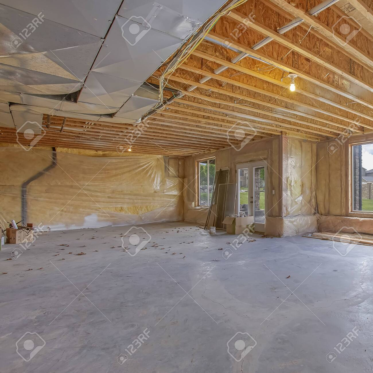 Square Unfinished house interior with air conditioning ducts..