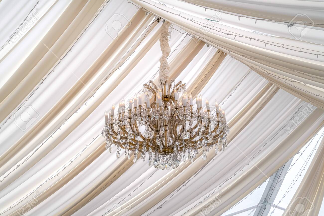 Picture of: Beautiful Chandelier With Crystals And Faux Candles At A Wedding Stock Photo Picture And Royalty Free Image Image 132668984