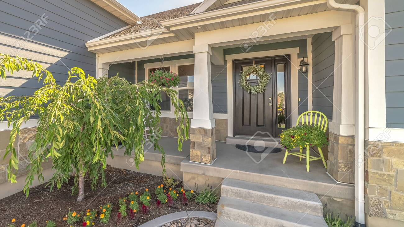 Pano Frame Home With Landscaped Yard Stairs Porch And Front Door