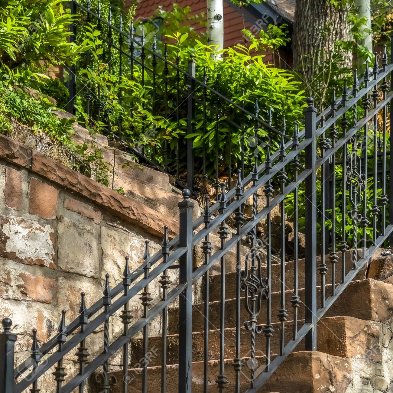 Square Frame Outdoor Staircase With Stone Steps And Black Metal Stock Photo Picture And Royalty Free Image Image 137238010