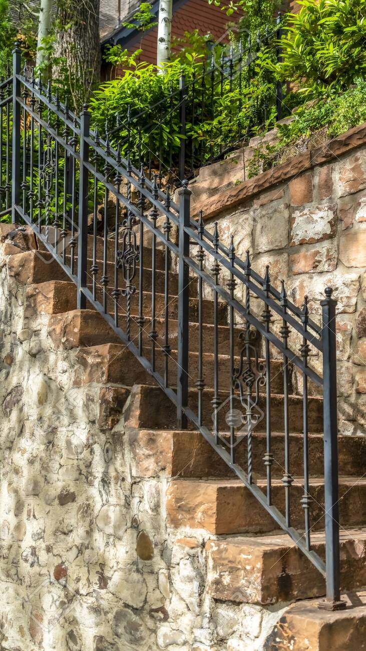 Vertical Outdoor Staircase With Stone Steps And Black Metal Railing Stock Photo Picture And Royalty Free Image Image 137237803