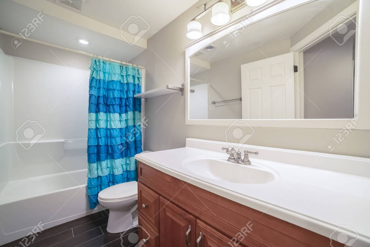 Interior Of A Small Modern Bathroom With Single Vanity Below Stock Photo Picture And Royalty Free Image Image 137654738