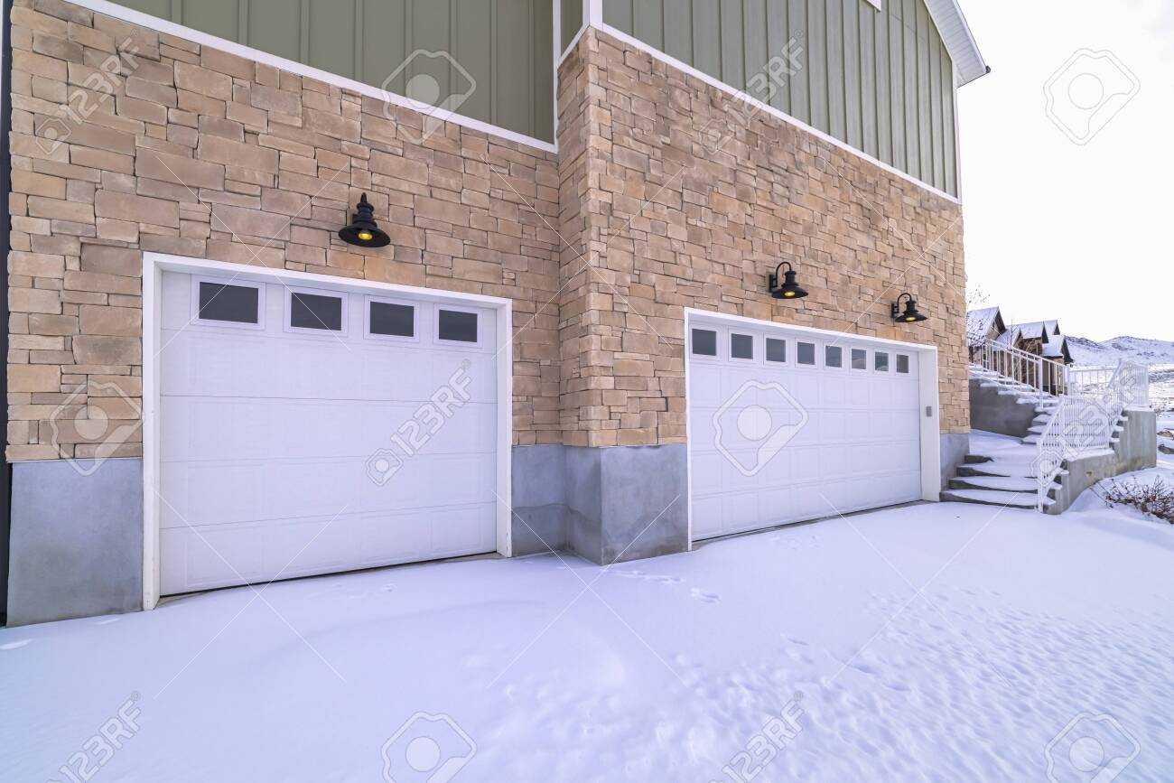 Snow Covered Forecourt With Double Garage Doors On A Large Brick Stock Photo Picture And Royalty Free Image Image 137675936