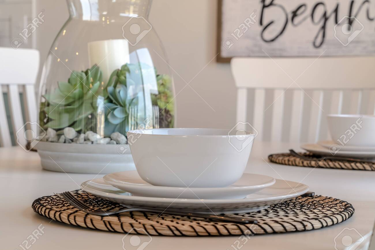 Dining Tableware And Round Placemat Against Candle And Plant Stock Photo Picture And Royalty Free Image Image 139153184