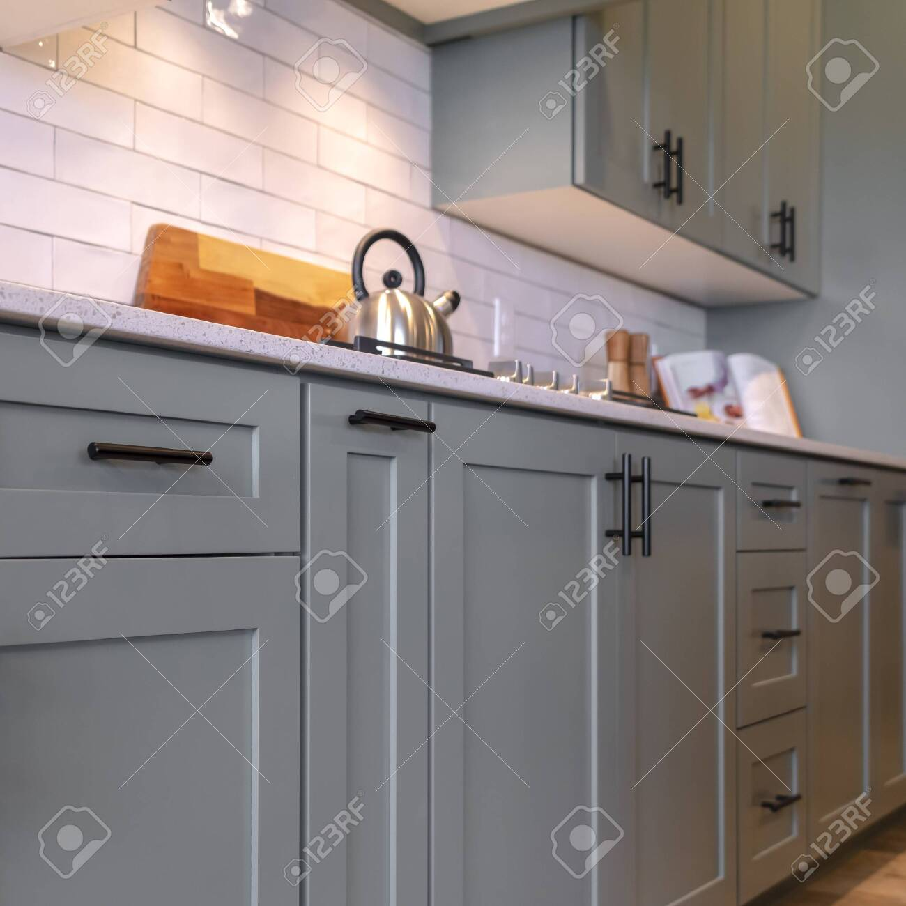 - Photo Square Kitchen Cabinets With White Countertop Black Handles