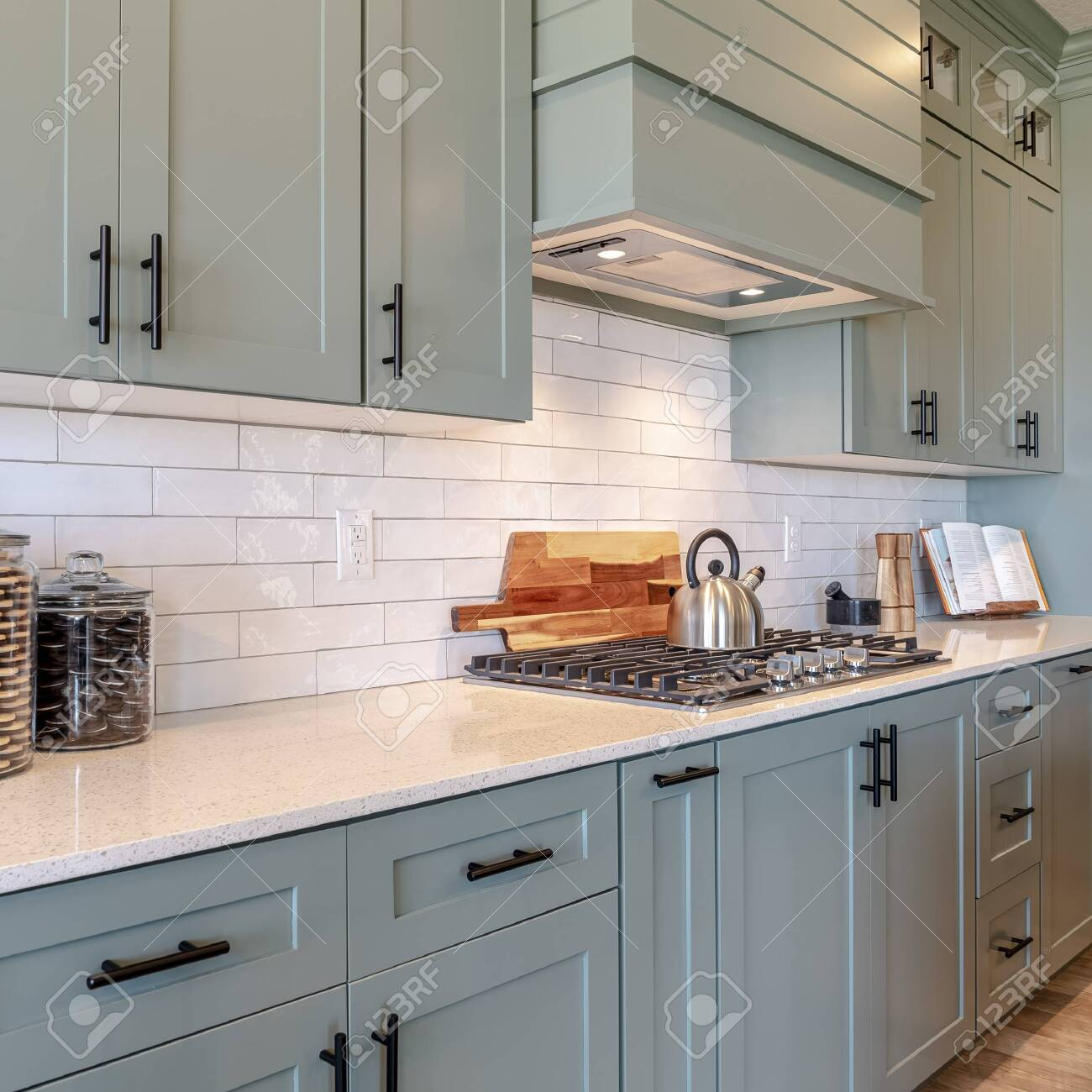 - Square Frame Kitchen Interior With Cooktop On White Counter Top