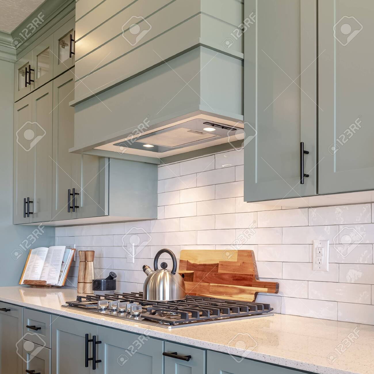 - Square Kitchen Interior With Cooktop On White Counter Top Under