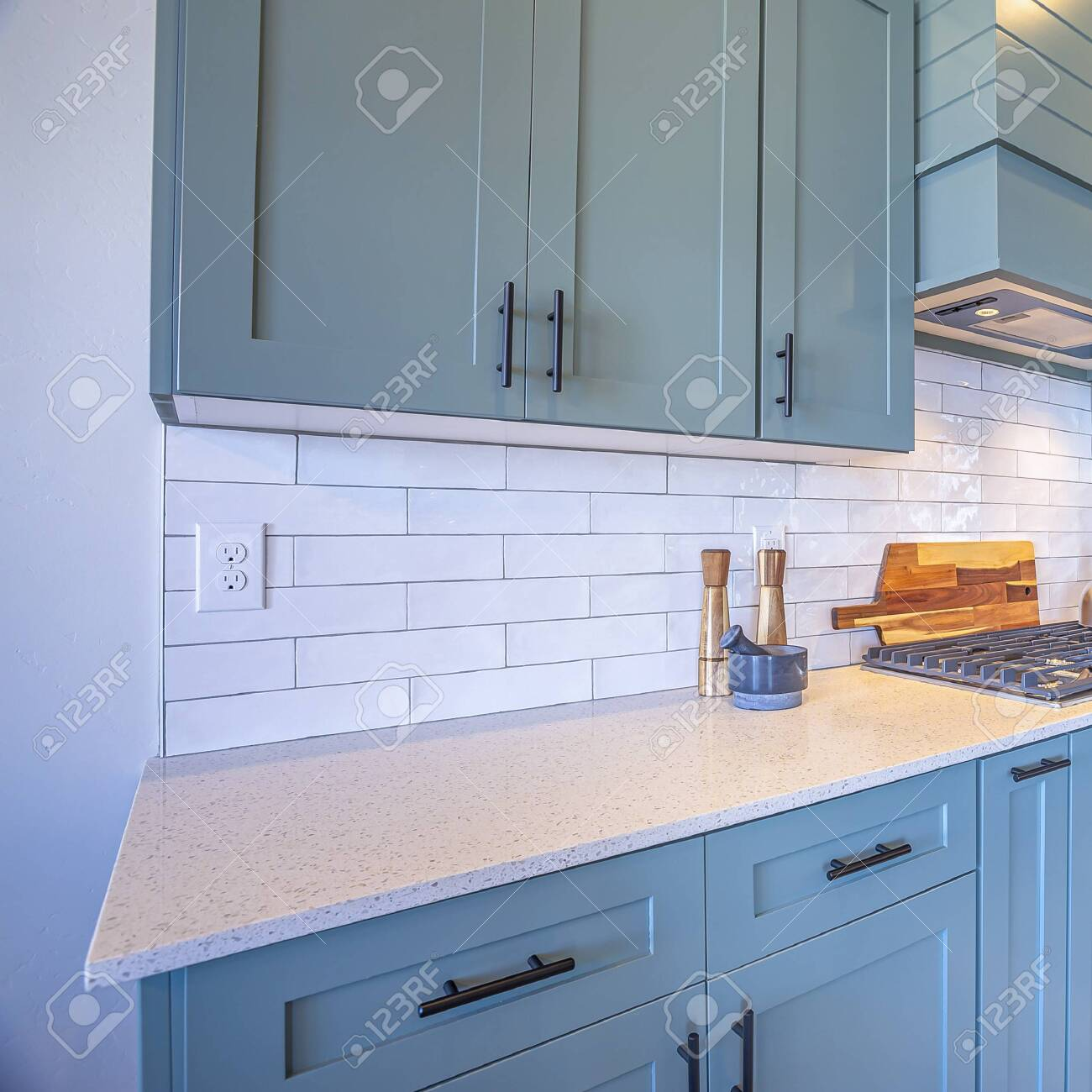 - Square Frame Kitchen With White Counter Top And Bluish Gray
