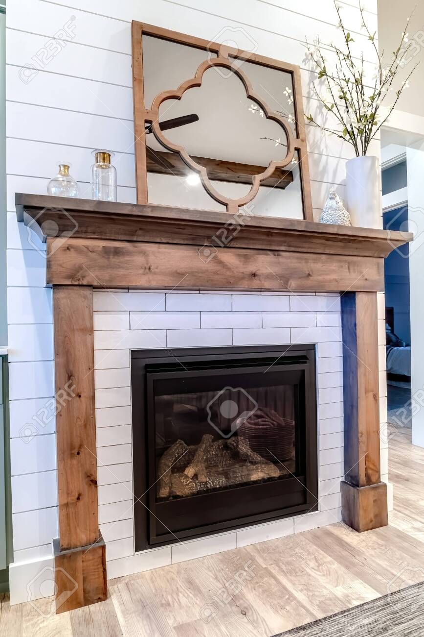 Modern Fireplace With Wooden Frame Against White Accent Wall Stock Photo Picture And Royalty Free Image Image 149173801