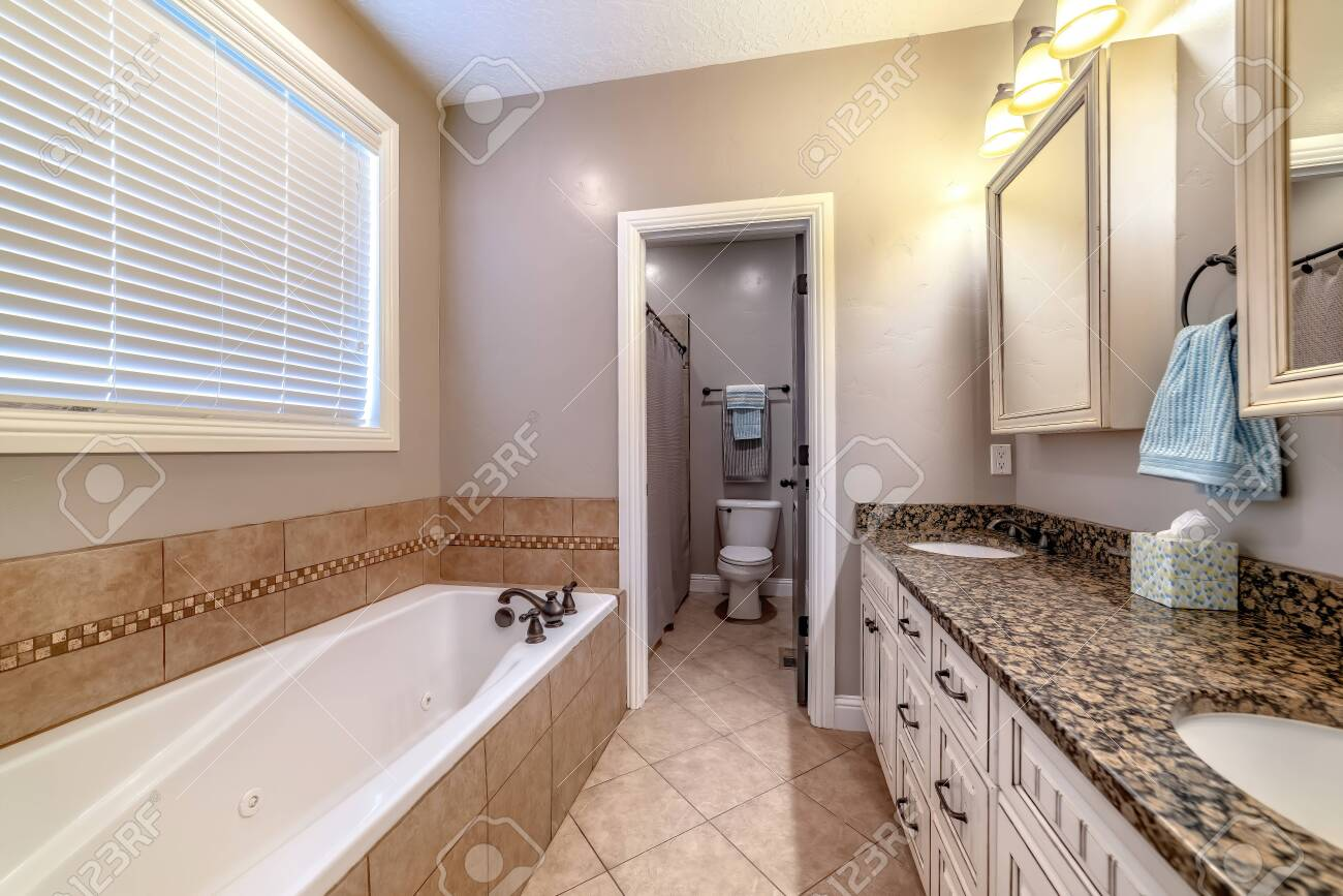 Bathroom Interior With Bathtub Double Sink Vanity Mirror Cabinets Stock Photo Picture And Royalty Free Image Image 149173655