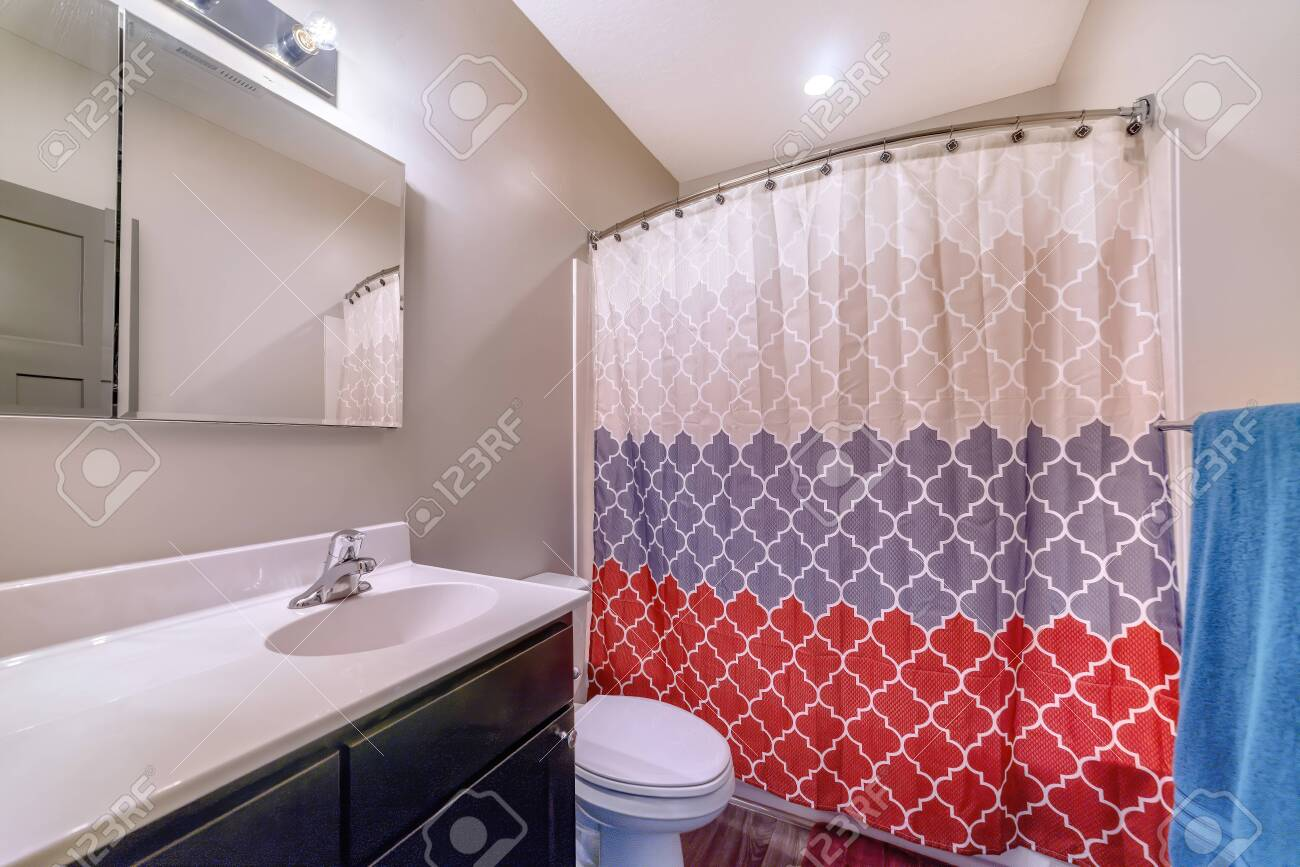 Home Bathroom With Toilet Vanity Area And Bathtub Conceled By Stock Photo Picture And Royalty Free Image Image 149175281