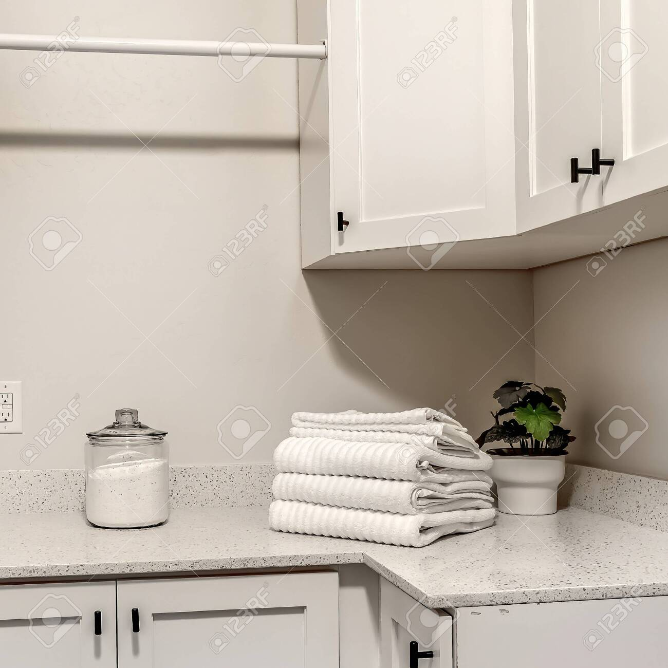 Square Laundry Room Of Home With White Wood Cabinets And Clothes Stock Photo Picture And Royalty Free Image Image 149181866