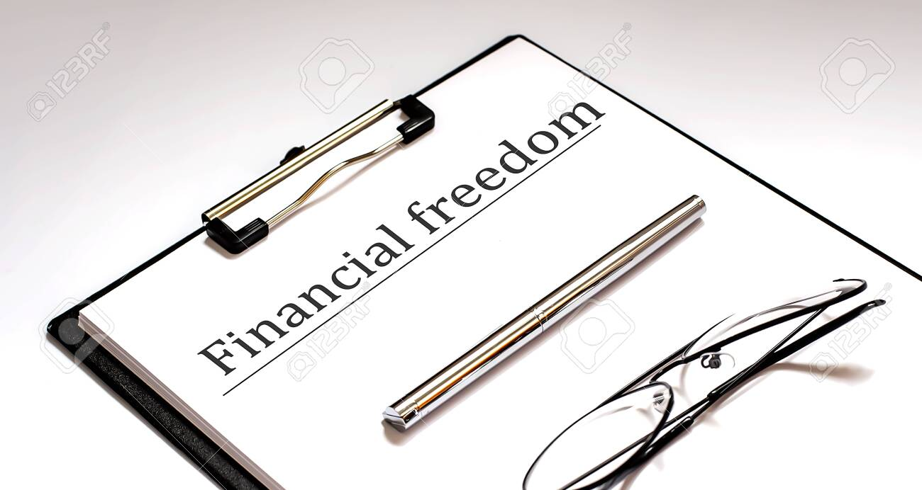 Financial Freedom Concept on the white sheet with pen and glasses - 155004162