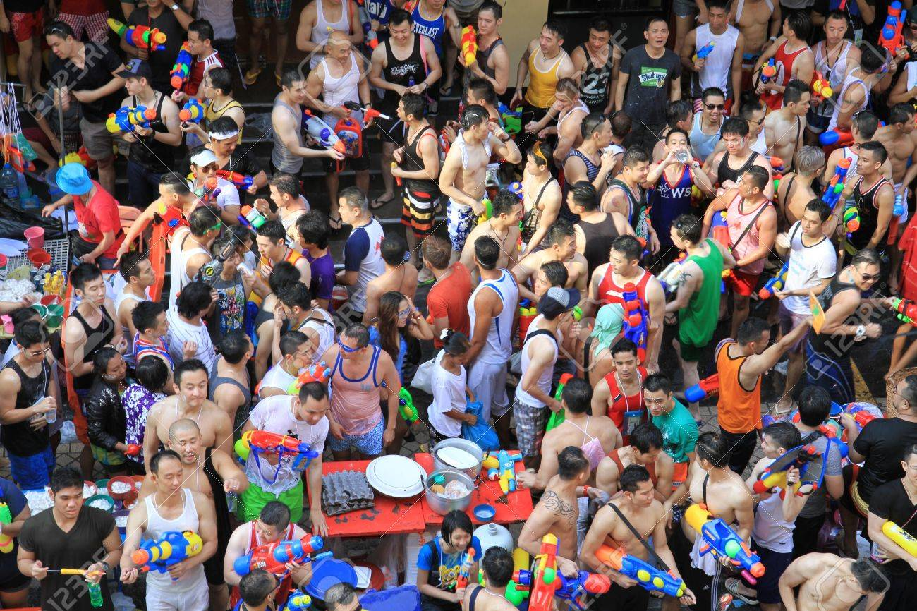 BANGKOK - APRIL 13  Crowd of people celebrating the traditional Songkran New Year Festival, April 13, 2012, Silom road, Bangkok, Thailand   Stock Photo - 13315408
