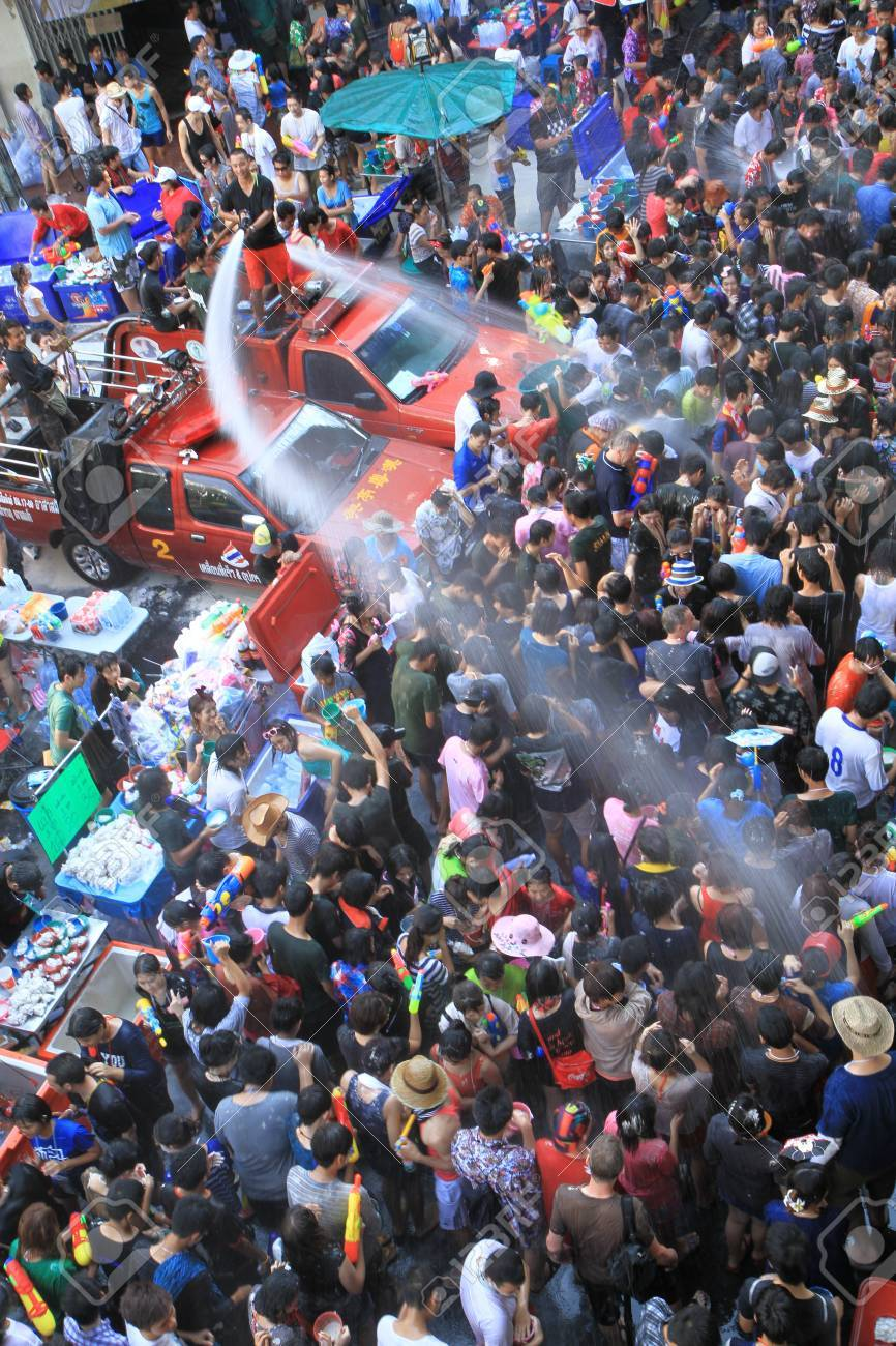 BANGKOK - APRIL 13  Crowd of people celebrating the traditional Songkran New Year Festival, April 13, 2012, Silom road, Bangkok, Thailand   Stock Photo - 13315422