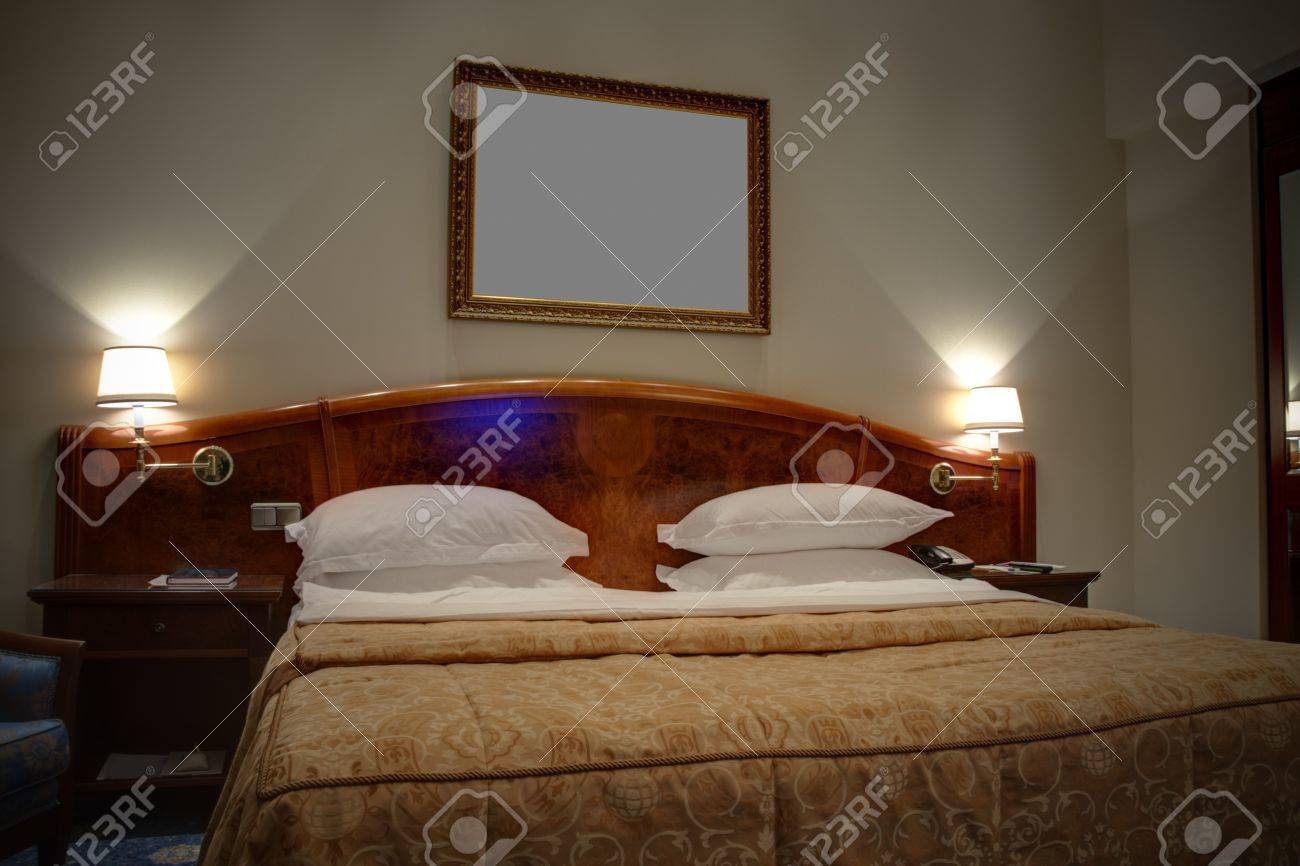 King size bed with bedside tables and lamps stock photo picture king size bed with bedside tables and lamps stock photo 19480785 geotapseo Images