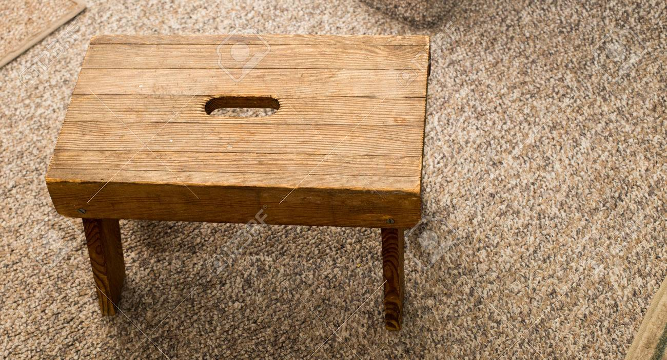 Peachy Small Four Legged Wooden Step Stool On Carpet Ibusinesslaw Wood Chair Design Ideas Ibusinesslaworg