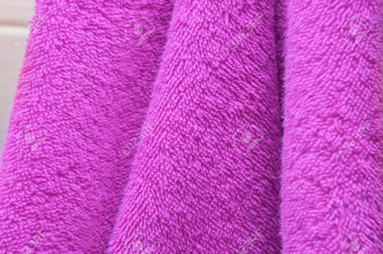 Enjoyable Wavy Dry Bath Towels Of Color Purple Hanging In Bathroom Close Up Home Interior And Landscaping Ologienasavecom