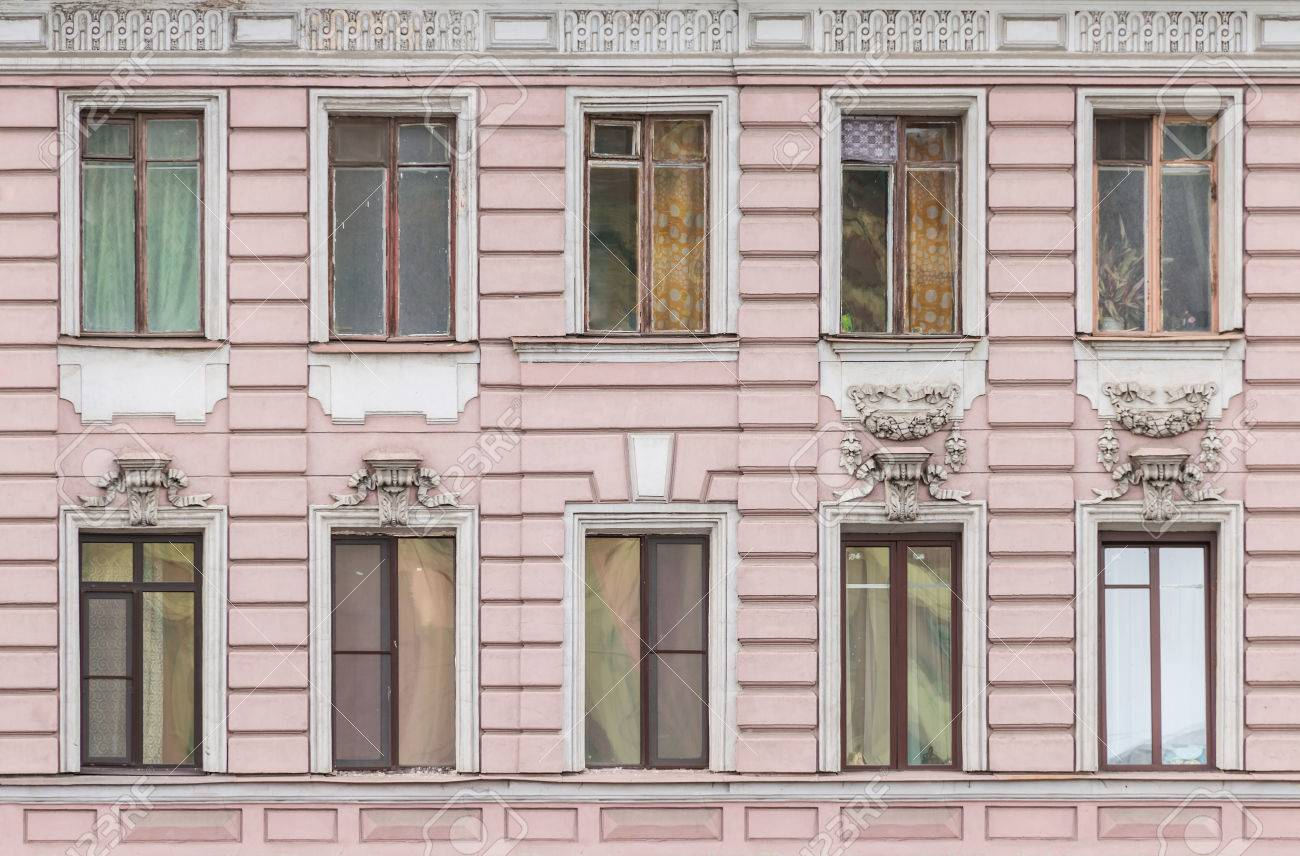 Apartment Building Front several windows in a row on facade of urban apartment building