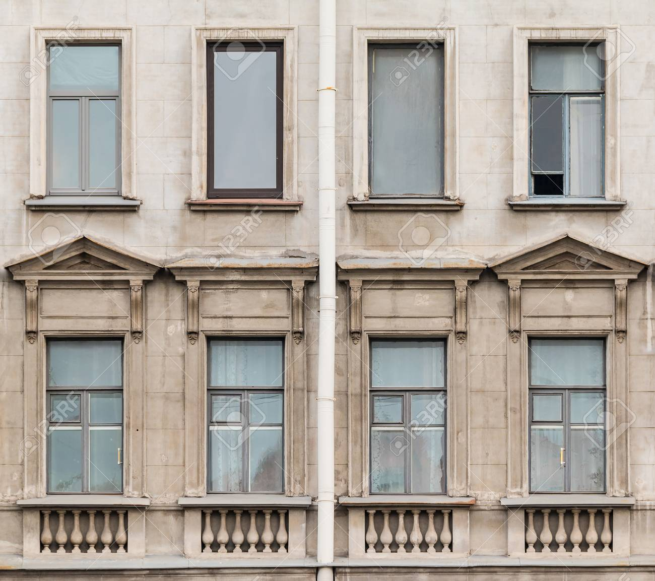 Several Windows In A Row On Facade Of The Urban Apartment Building Front  View, St