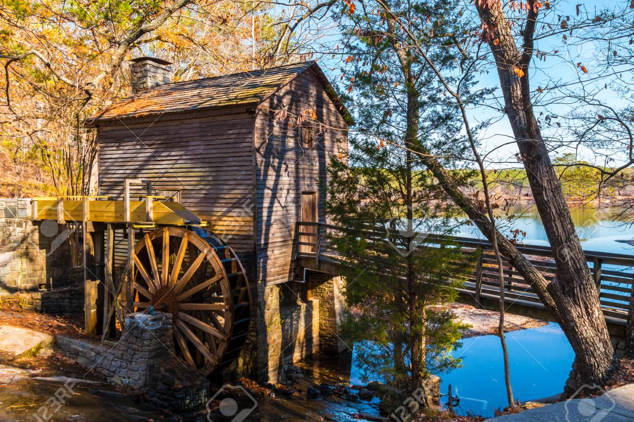 Grist Mill And Stone Mountain Lake In The Stone Mountain Park