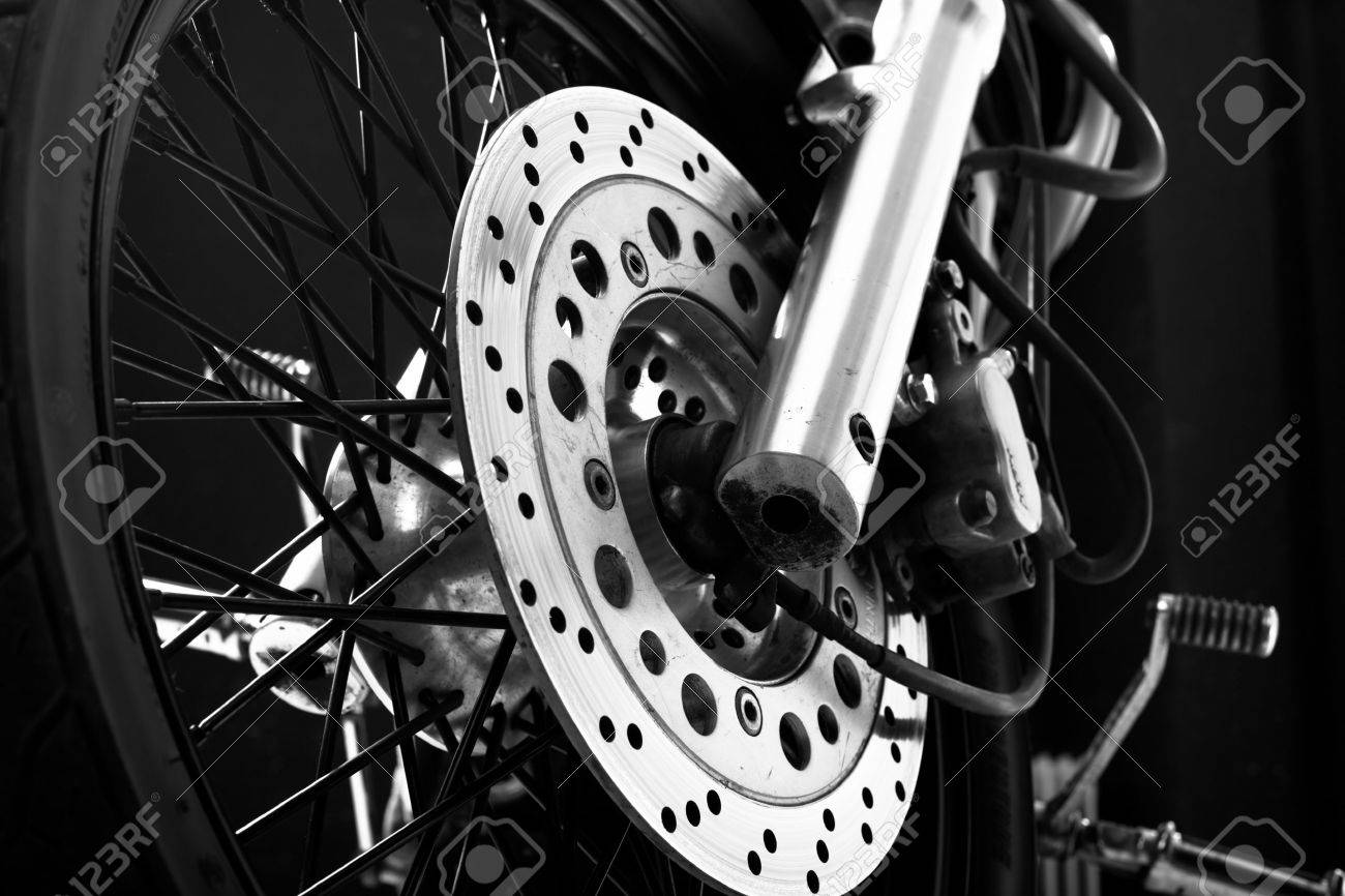 4416767-Closeup-detail-of-a-motorcycle-front-wheel-with-black-spikes-and-brake-disc-Stock-Photo.jpg