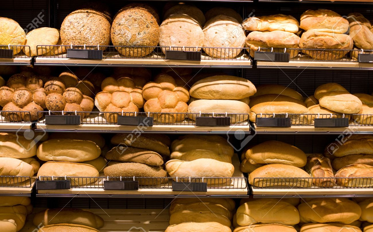 various bread type on shelf bakery shop concept stock photo