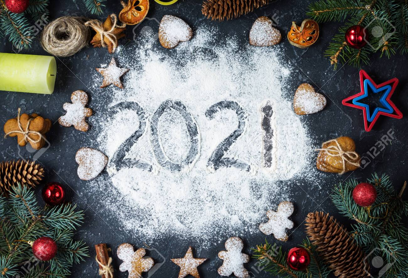 2021 Christmas Cookies Happy New Year 2021 Written On Flour And Christmas Decorations Stock Photo Picture And Royalty Free Image Image 156573218