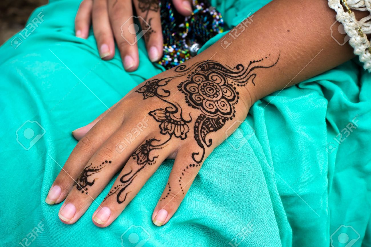 Closeup Photo Of Female Hands With Henna Tattoo Mehndi On Bright