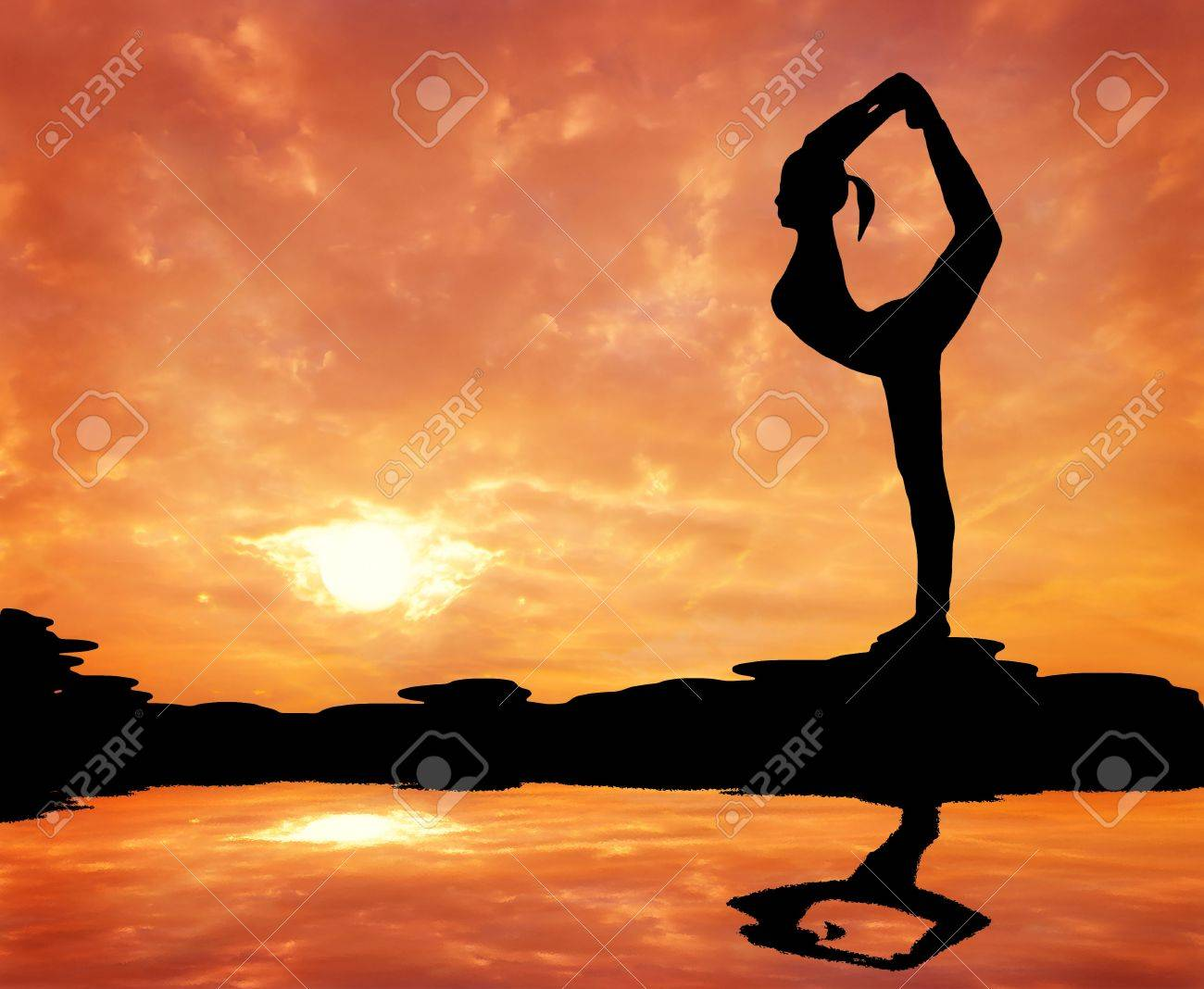 silhouetted of a beautiful woman Yoga in the morning Stock Photo - 13194004