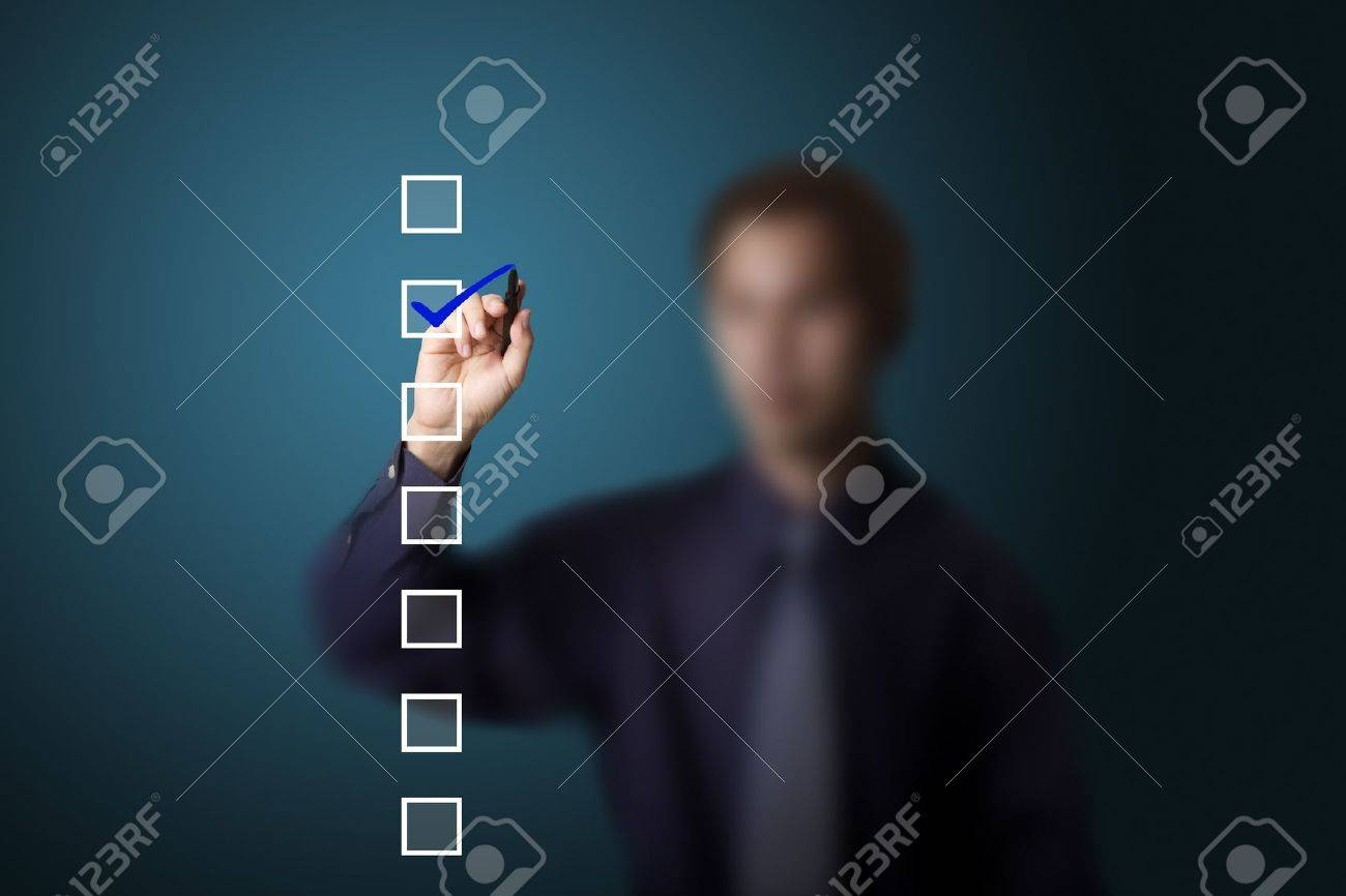 business man checking on a checklist box Stock Photo - 13193867
