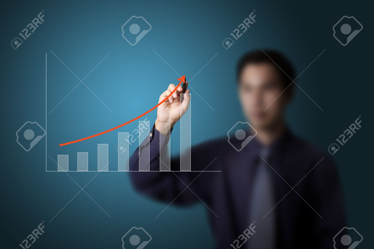 business man drawing upward trend graph on white board Stock Photo - 13193863