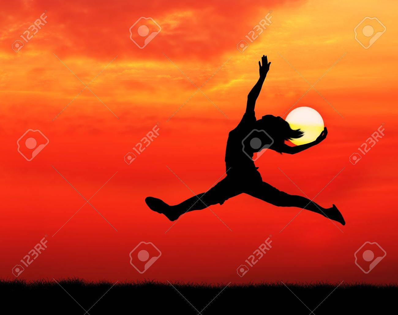 happy woman jumping and holding the sun at sunset silhouetted Stock Photo - 13224349