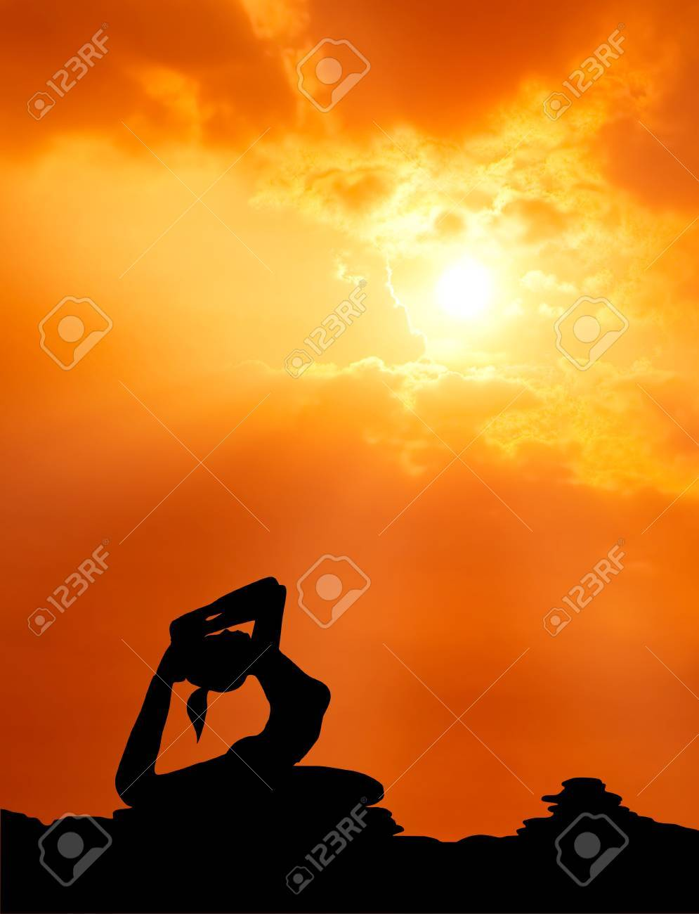 healthy woman  practice yoga at sunset silhouetted Stock Photo - 13224538