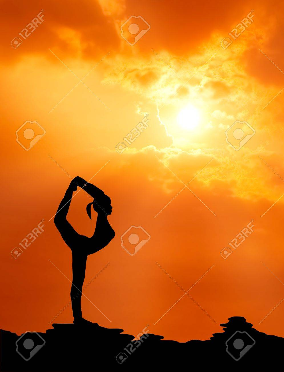healthy woman  practice yoga at sunset silhouetted Stock Photo - 13224542