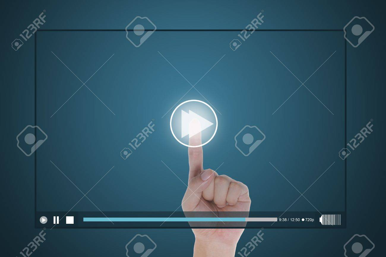 hand push fast forward button on touch screen to run video clip Stock Photo - 13224351