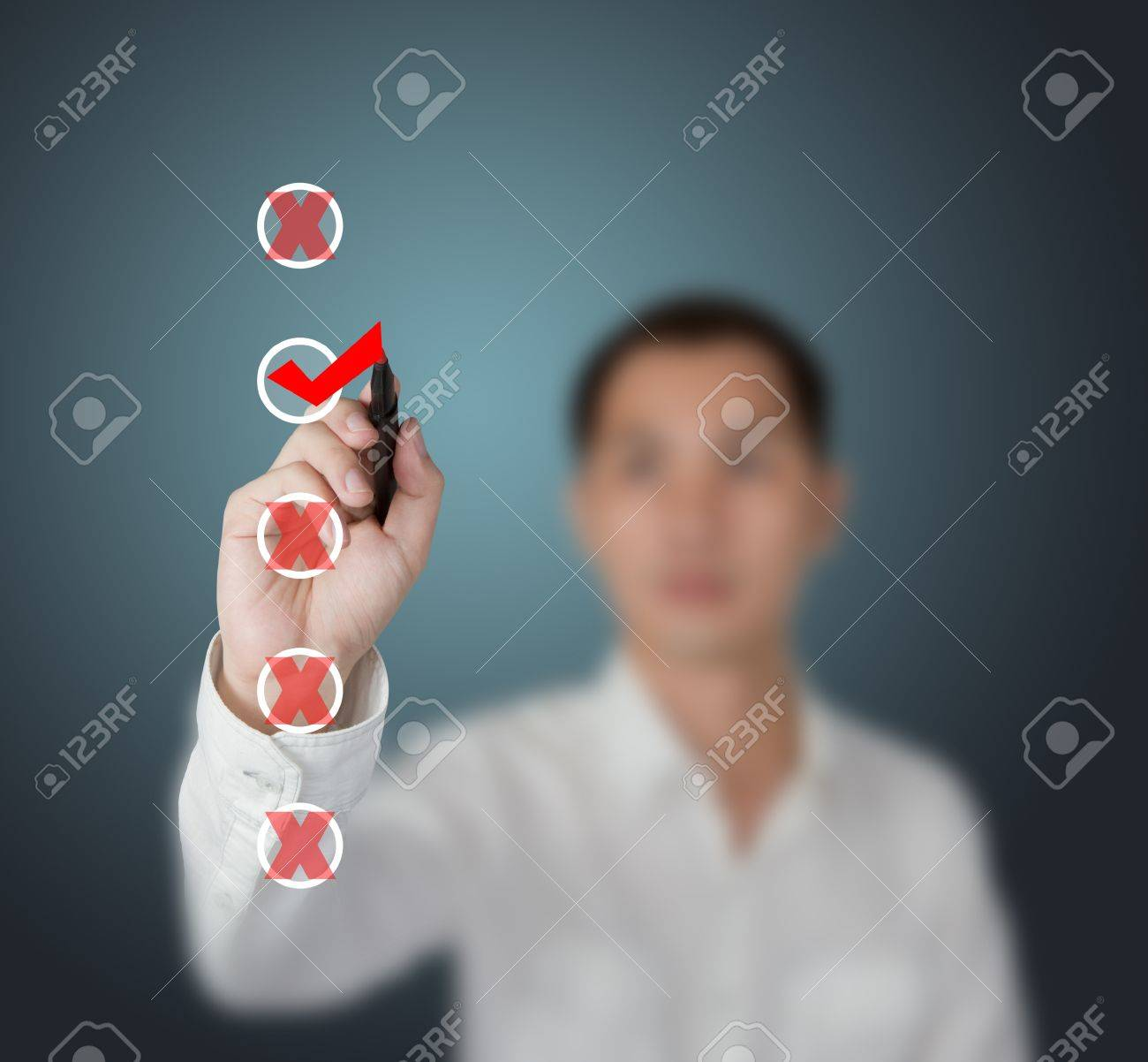 business man checking right and wrong mark on checklist boxes Stock Photo - 13224548