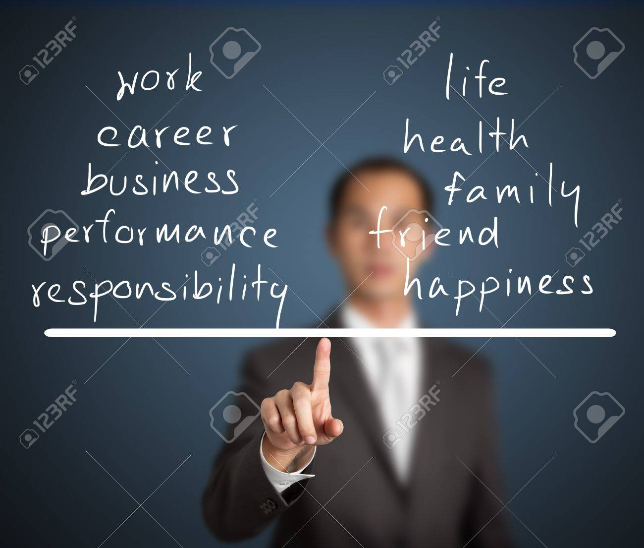 business man balance his work and life on finger tip Stock Photo - 13613183