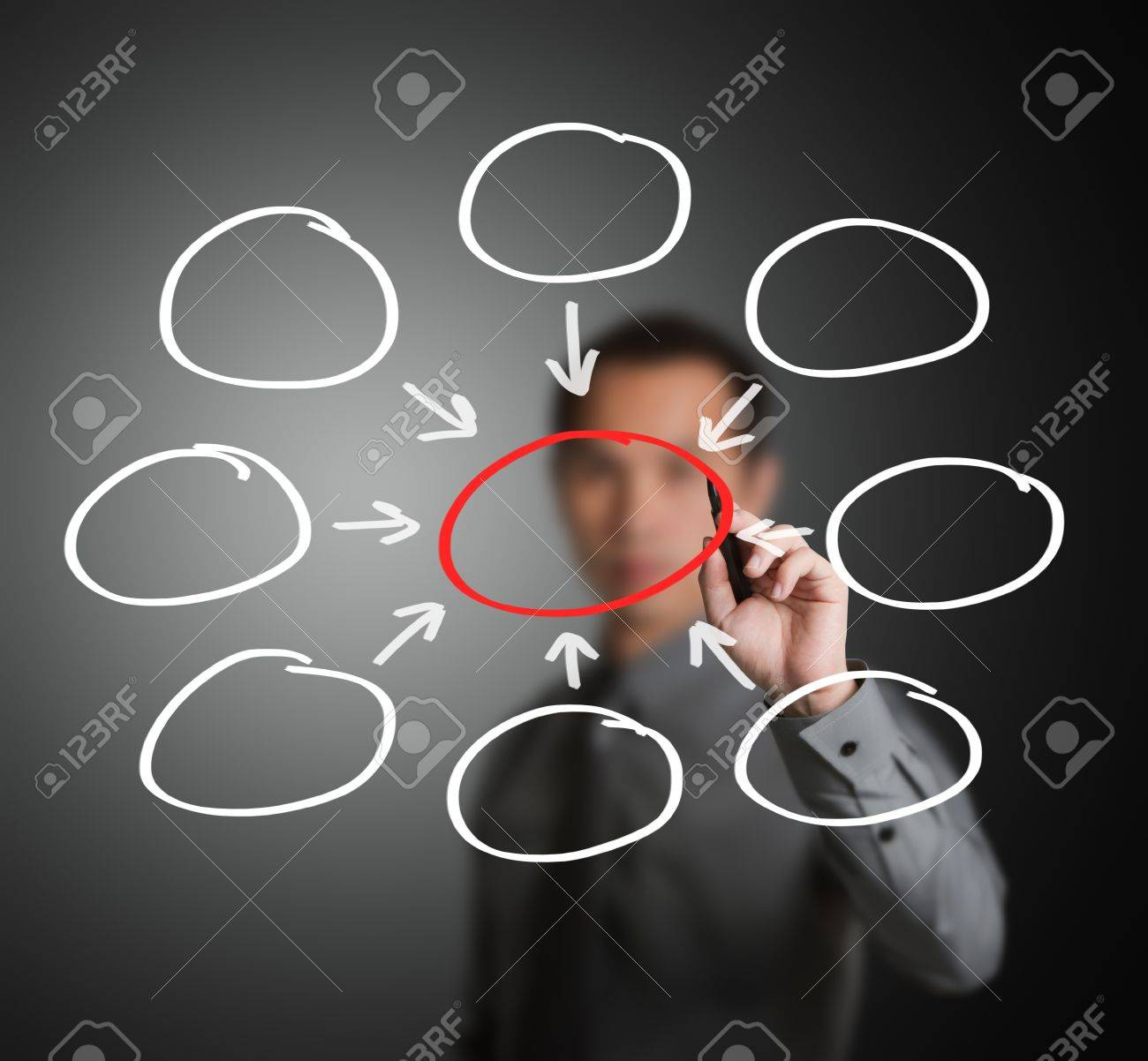 business man writing one core centralize from eight component diagram in blank Stock Photo - 14369934