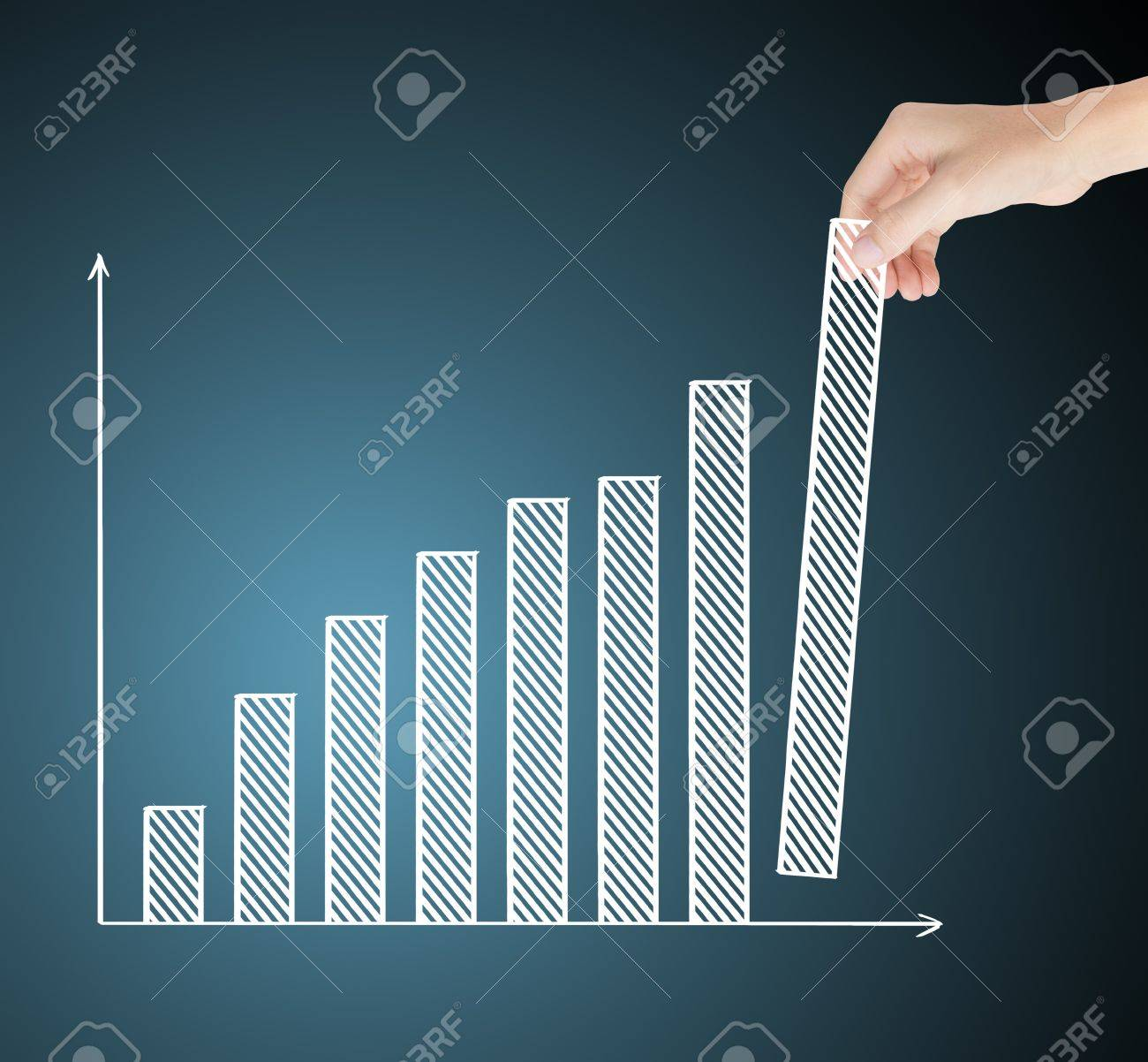 business hand building upward trend financial graph Stock Photo - 16450364