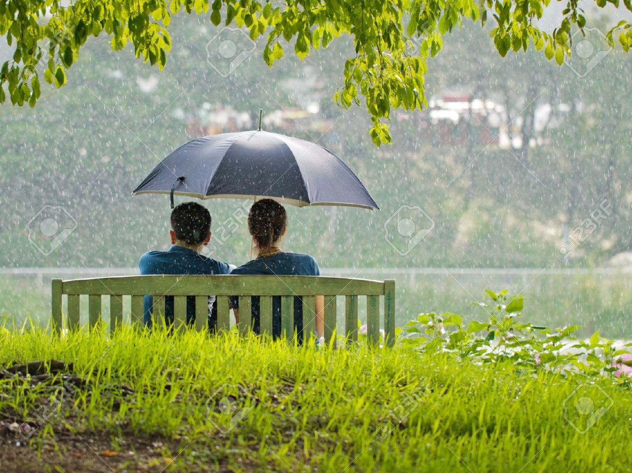 Simple Wallpaper Love Rain - 15048146-A-couple-on-a-bench-under-umbrella-Stock-Photo-couple-love-rain  Gallery_511006.jpg