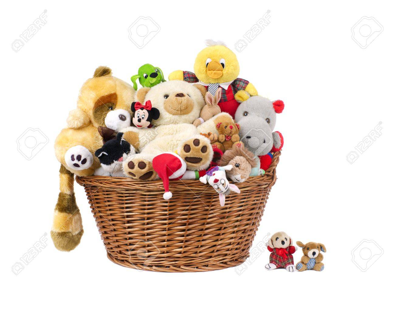 Stuffed animal toys in a basket isolated on a white - 35879986