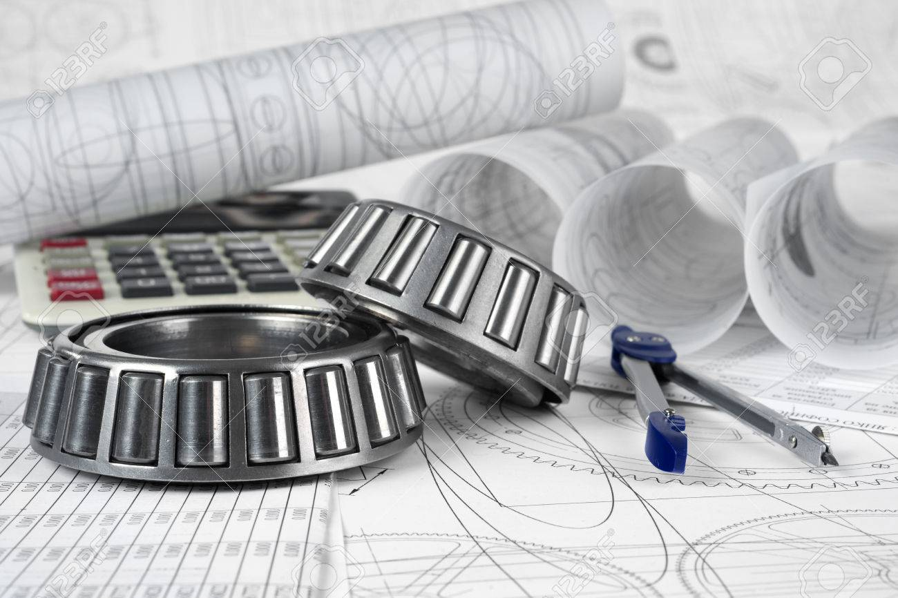 roller bearings, compasses, calculator and drawings - 35937906