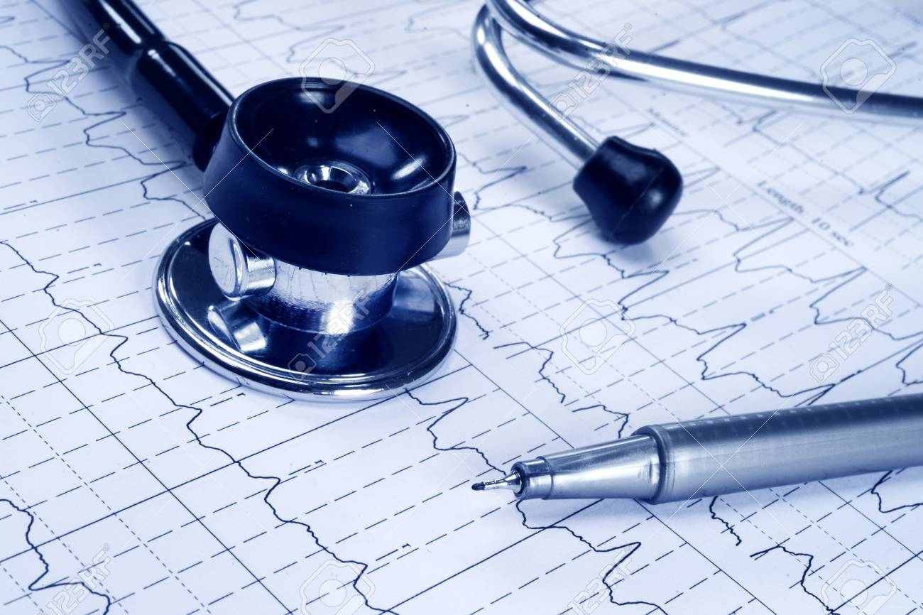 Stethoscope and technical pen on the cardiogram background - 35982949