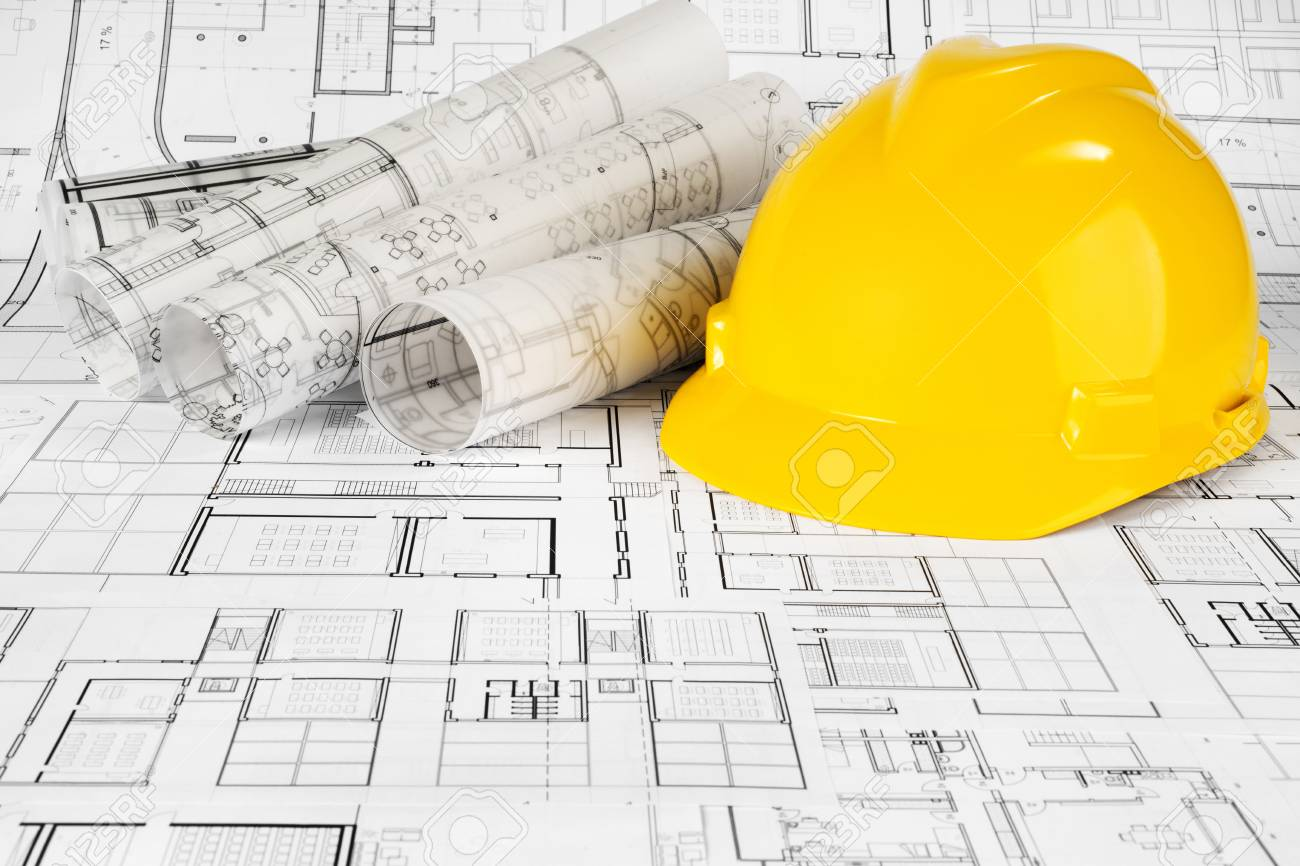 Yellow helmet and project drawings - 99910672
